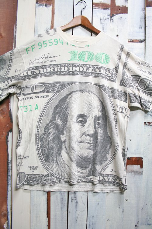 <img class='new_mark_img1' src='//img.shop-pro.jp/img/new/icons43.gif' style='border:none;display:inline;margin:0px;padding:0px;width:auto;' />90s 100ドル柄 ドル柄 総柄 Tシャツ ビンテージ 古着 ベンジャミンフランクリン