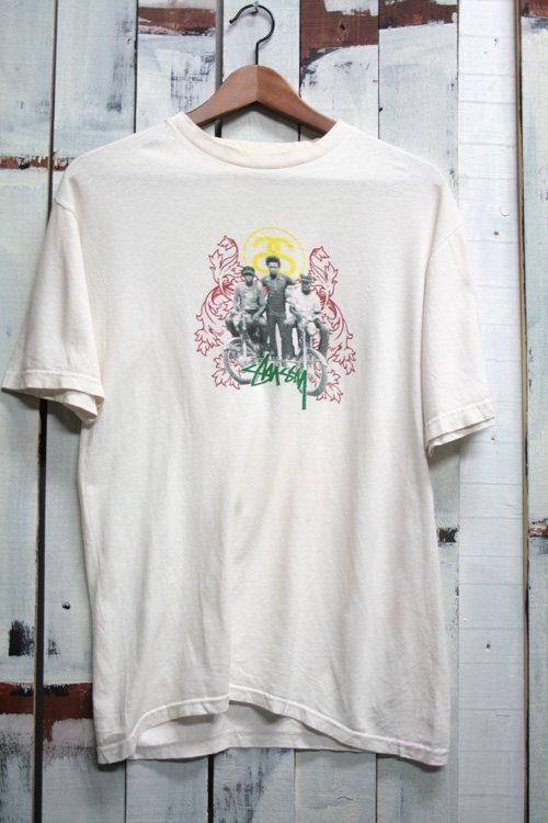 古着 STUSSY ステューシー Tシャツ プリントTシャツ オフホワイト 白 シャネル ロゴ ラスタ レゲエ サーフ スケート ボロ