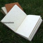 手織り生地とロクタ紙のノートブック